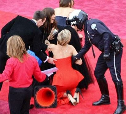 Jennifer Lawrence trips again at the Oscars 2014